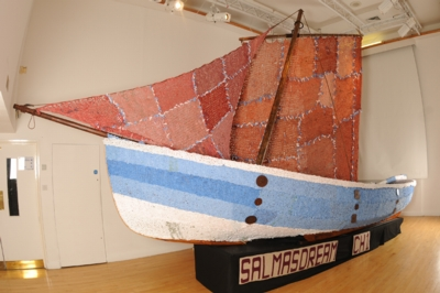 Wooden boat with knitting covering and knitted sail