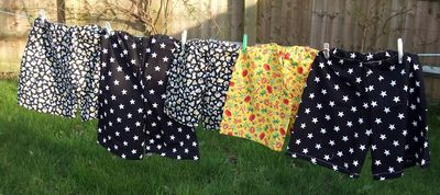 Shorts made from pillowcases hung on a washing line
