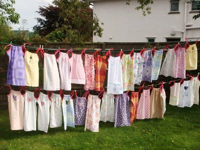 Dresses made from pillowcases hung on a washing line
