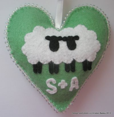 Green felt heart with white sheep and 'S&A' appliques