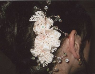 Bride wearing her hairslide of beaded satin flowers