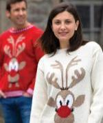 Man and woman wearing Rudolph the Reindeer jumpers