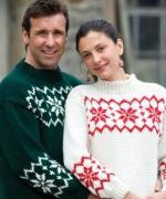 Man and woman wearing snowflake motif jumpers