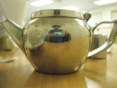 Me taking a photo of my reflection in a metal teapot