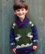 Boy wearing knitted jumper with reindeer motif