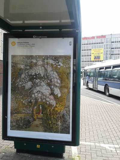 Bus stop poster of a painting of a tree with pink blossom