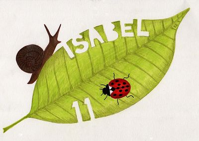 Snail and ladybird crawling across leaf which has 'Isabel' and '11' eaten out of it.