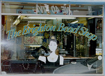 Audrey Hepburn cut-out in window of shop