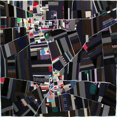 Elaborate abstract design quilt reminiscent of an aerial city map