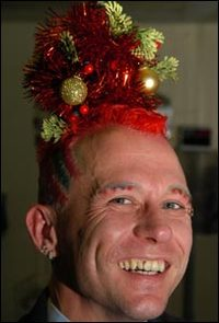 Mark Davis, from Pontypool, who has had a small red Christmas tree woven into his hair, which is also dyed red. Image: Wales News, via BBC.com