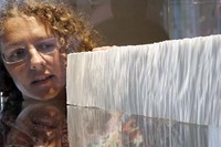 Rachel Hazell with a section of her work 'Ice Cliff'. Copyright © craftscotland