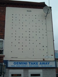 The poem 'Rain' by Lemm Sissay, painted on a wall on Dilworth Street, off Oxford Road, Manchester (c) Kristen Bailey 2006