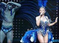 Kylie Minogue in blue corset and feathered headress on 2005 Showgirl tour