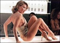 Kylie Minogue in gold top and hotpants in Spinning Around video