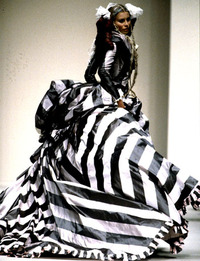 Catwalk model in stripy taffeta ballgown